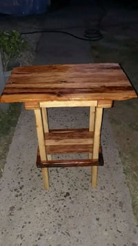 Tall red wood table.