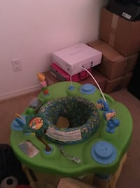 baby's green and white activity saucer