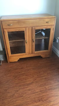 Brown wooden cabinet with shelf Surrey, V3S 3P4
