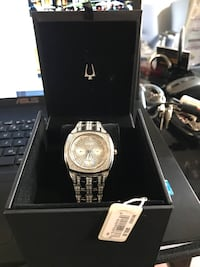 square gold analog watch with link bracelet with box