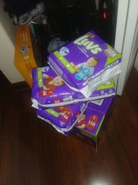 4 packs of Luvs Diapers