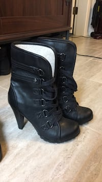Pair of black leather heeled boots Vancouver