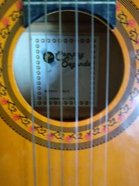 brown and black classical guitar 547 km