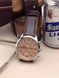 Round silver fossil chronograph watch with brownleather strap. Almost new, factory-condition with case.