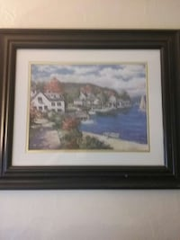 white and black house beside blue ocean painting