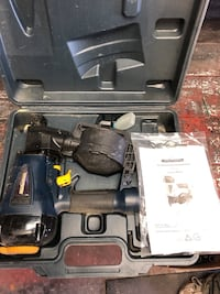 black and gray power tool in case
