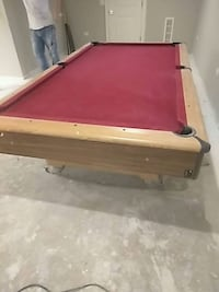 brown and red pool table