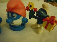 two blue and yellow plastic toys null