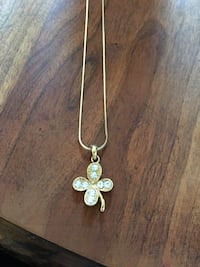 Gold-colored clover pendant necklace