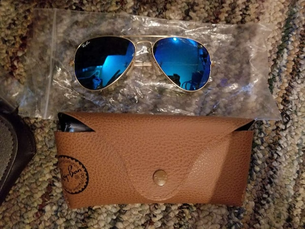 brass framed blue ray-ban sunglasses with brown leather case