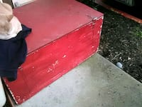 red and black wooden chest