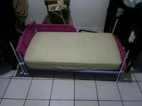 white and purple baby bed frame and matress North Miami Beach, 33179