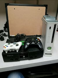 black Xbox 360 with two controllers 582 mi