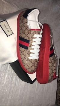 pair of red Gucci low-top sneakers 550 km