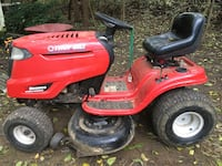 Red and black troy-bilt riding mower 44 km
