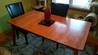 rectangular brown wooden dining table 745 km