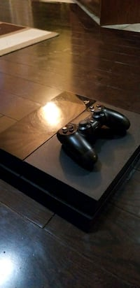 black Sony PS4 game console with controller Brampton