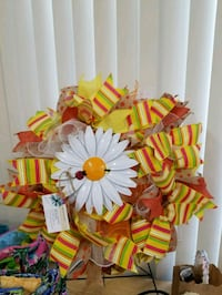 white metal daisy and yellow-green-and-red textile wreath Elkridge, 21075