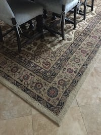 White, black, and brown floral area rug Little Rock, 72223