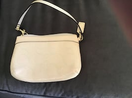 Used Coach wristlet cream