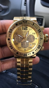 round gold-colored Rolex chronograph watch with link bracelet 778 mi
