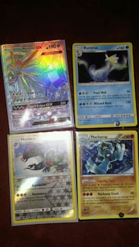 four assorted Pokemon trading cards Charleston, 25387