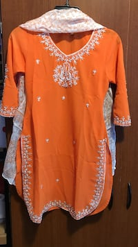orange and white floral long-sleeved dress
