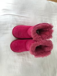 Pair of red fur boots 396 mi