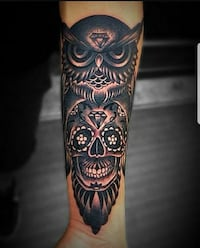 black calavera and owl arm tattooes 33 km