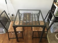rectangular black metal framed glass top table with chairs Arlington, 22204