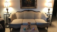 Vintage comfy couch with matching chair. Chair has a hair line crack under left arm of chair .