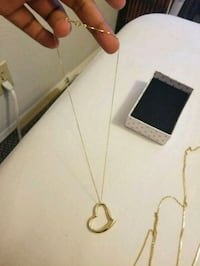 gold-colored pendant necklace