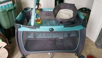 baby's black and blue travel cot 67 km