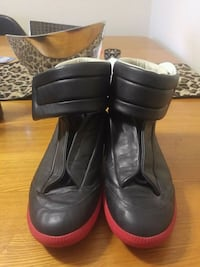 pair of black leather boots London