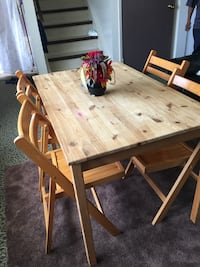rectangular brown wooden table with four chairs dining set Edmonton, T6K 0J9