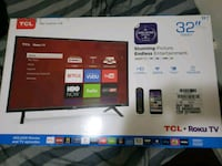TCL tv and the box and TV stand Queens, 11417
