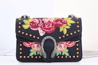 black and multicolored floral bag