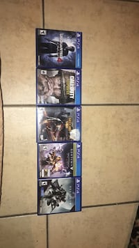 Four assorted ps4 game cases Whittier, 90605