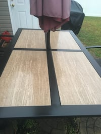 """Patio table set with six chairs and umbrella with base. Ceramic tile inlay 6'x3'-4"""". Negotiable  Conway, 29527"""