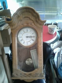 brown wooden pendulum clock 46 km