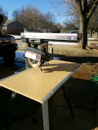 """10"""" radial saw with stand and casters"""