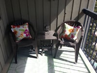 Two brown chairs and small foldable table