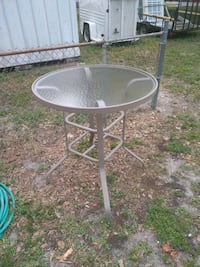 round gray metal framed glass top patio table Clearwater, 33760