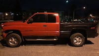 red Dodge Ram extra cab pickup truck 73 km
