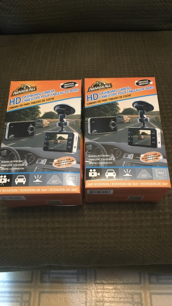 Two gray action camera still in boxes $75 each never used