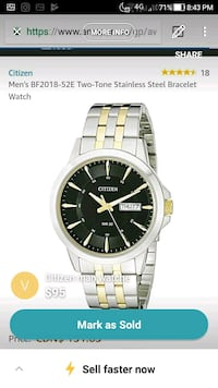 round silver Seiko analog watch with link bracelet screenshot