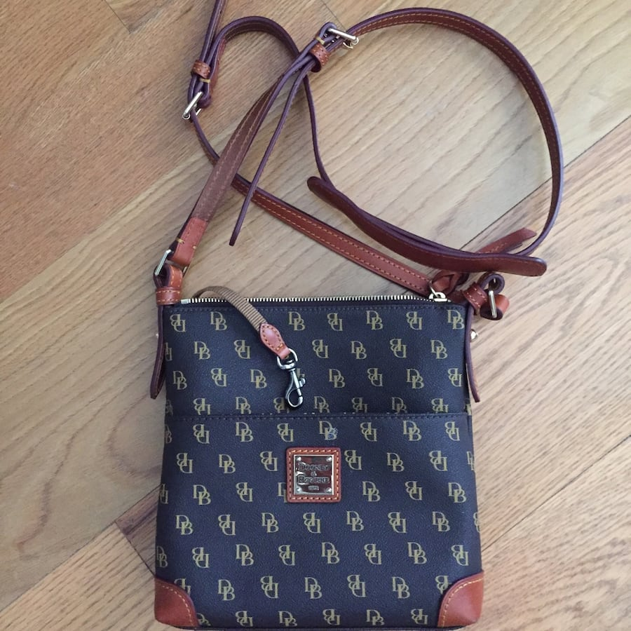 Black and brown leather dooney and bourke monogram crossbody bag