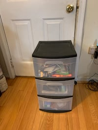 Three drawer plastic bin including contents