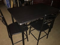 rectangular black wooden table with four chairs dining set 534 km