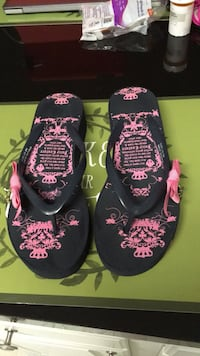 Used Juicy Couture Black and pink wedge flip flops. Size 8. Missing one charm on side Laurel, 20723